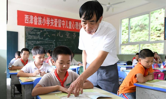 Pic story of boarding school principal in China's Fujian