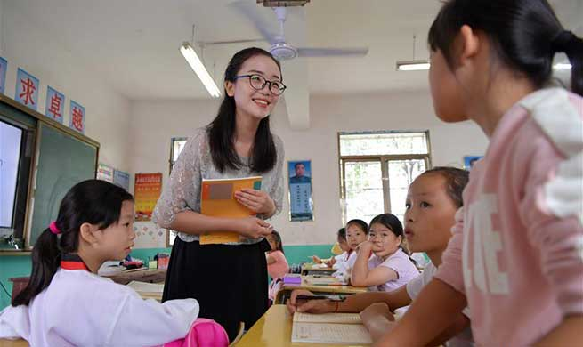 Pic story of teacher who devotes herself to rural education in China's Jiangxi