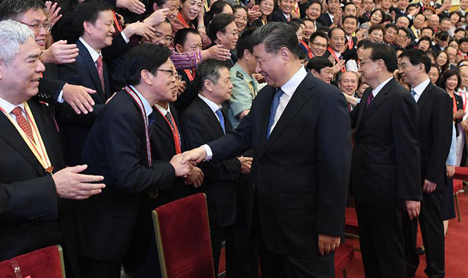 Xi meets representatives of outstanding units, individuals in education circles