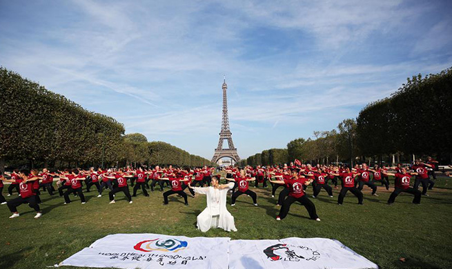 People practice Qigong in Paris, France