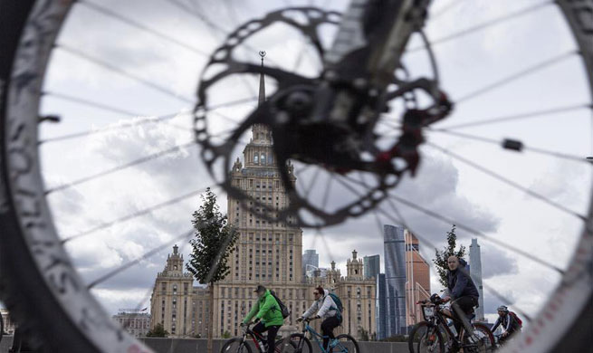 People ride bicycles during Moscow Autumn Cycling Festival