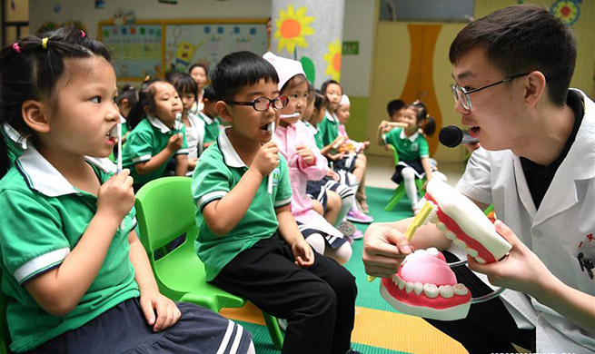 Dental care activity held in kindergarten in Hefei, E China's Anhui