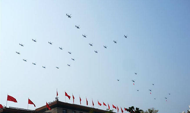 Military parade starts with flag-guarding echelon flying over Tian'anmen Square