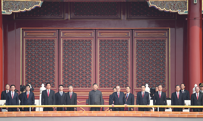 Xi ascends Tian'anmen Rostrum to attend National Day celebrations