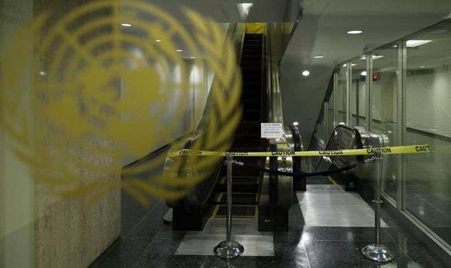 Feature: Escalators, fountain stop functioning -- UN tightening belt to tide over financial crisis