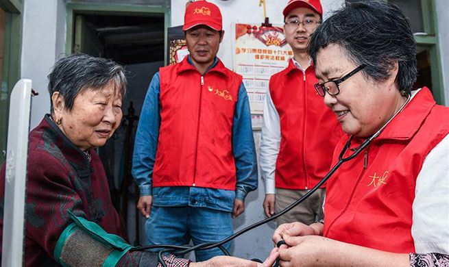 Teams of volunteers provide different services in community of Yuyao, China's Zhejiang
