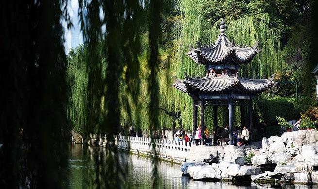 Tourists view scenery along moat in Jinan, China's Shandong