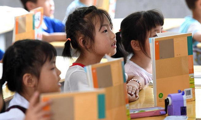 Pic story: first primary school built under Project Hope in China