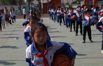 Village school in Shanxi, China promotes basketball workouts during morning break