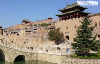 Castle-like village in north China attracts many tourists