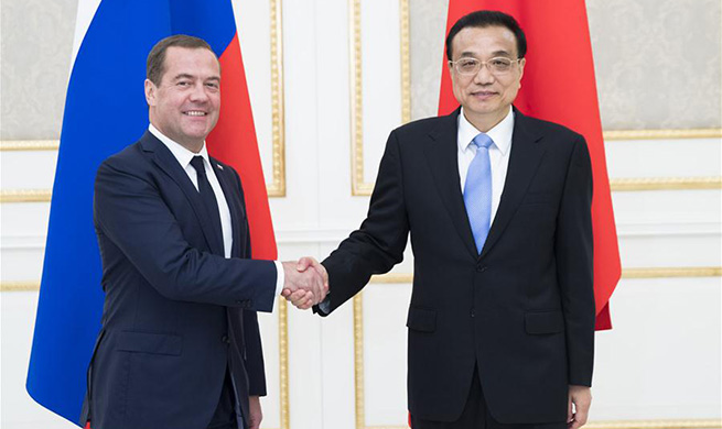 Chinese premier meets Russian PM on SCO, bilateral cooperation