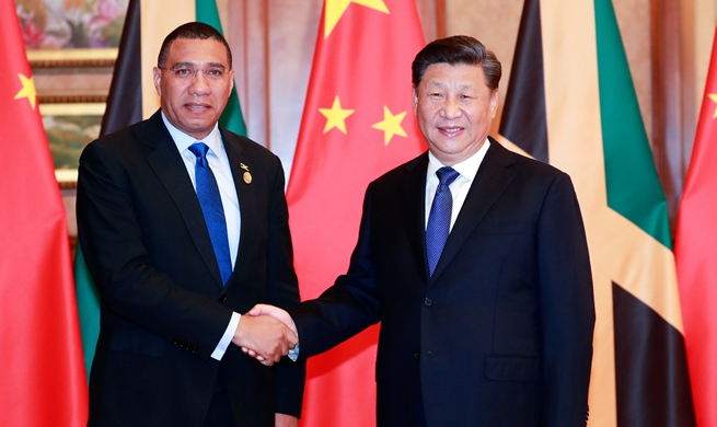 Xi meets Jamaican prime minister