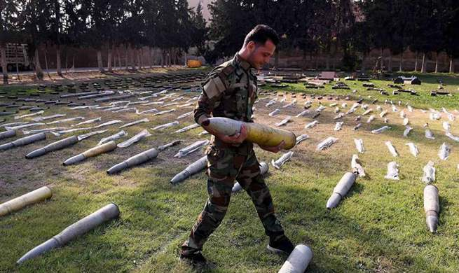 Syrian army confiscate weapons found in formerly rebel-held areas in Syria