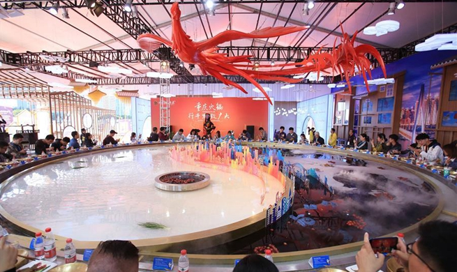 In pics: extra large hotpot at exhibition area of 2nd CIIE