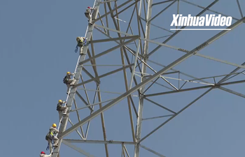 Chinese workers complete world's first operation on 1,100-kV DC transmission line