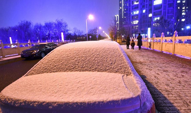 Snow falls in Beijing