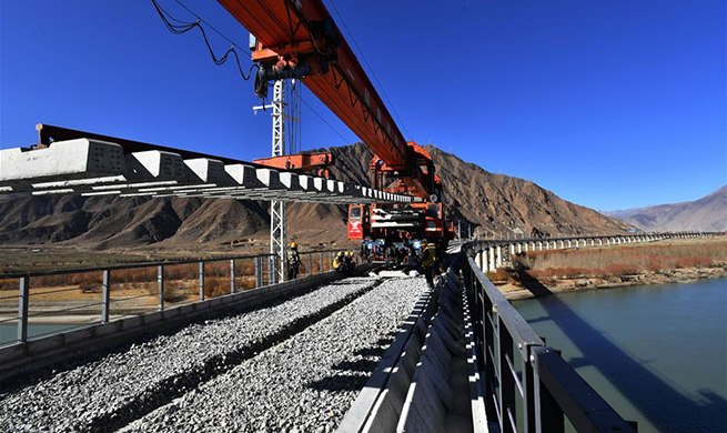 Rail-laying work for 4,615-meter-long bridge crossing Yarlung Zangbo River completed