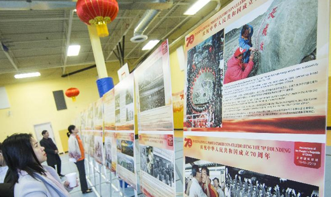 Photo exhibition marking 70th anniversary of PRC's founding held in Canada