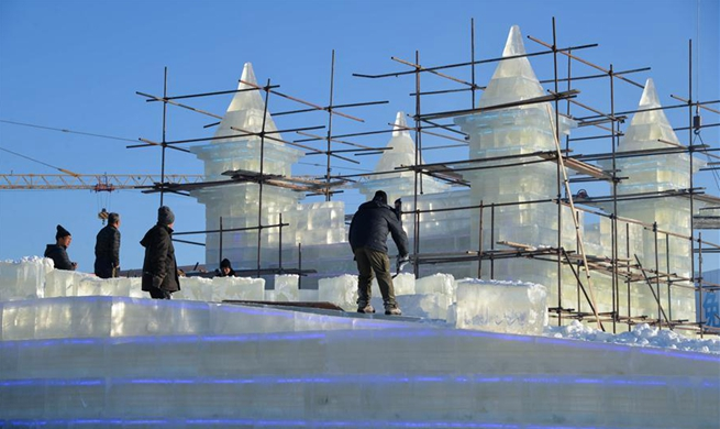 Workers make ice sculptures in Manzhouli for China-Russia-Mongolia ice snow festival