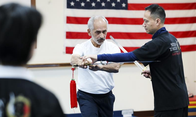 Feature: Former world champion brings Tai Chi into New Yorkers' life