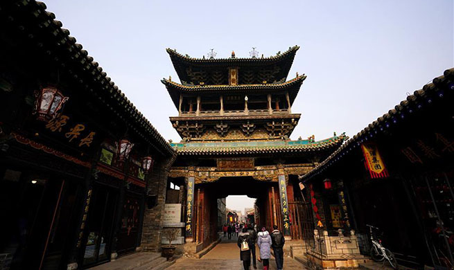 Tourists visit ancient city of Pingyao in N China's Shanxi