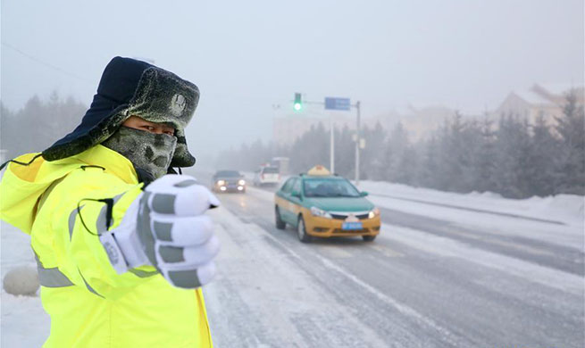 Mohe traffic police work outdoors in extremely cold weather