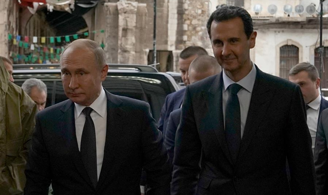 Putin visits Damascus, meets Syrian president
