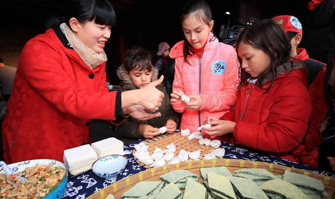 Foreigners attend activity featuring Chinese Lunar New Year customs in China's Zhejiang