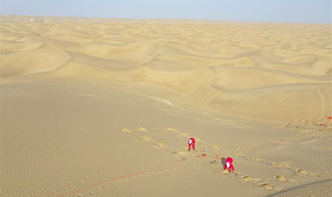 Oil exploration workers engaged in hard work in Taklimakan Desert, Xinjiang