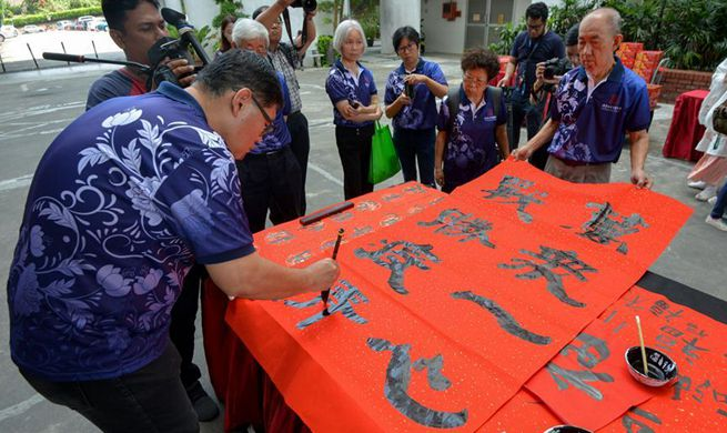 People in Malaysia participate in calligraphy event to show solidarity with China's fight against novel coronavirus