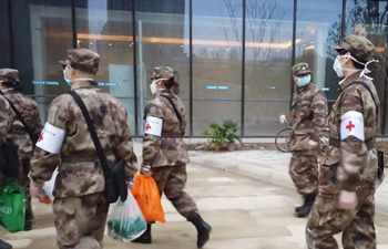 Chinese military medics take over another hospital in Wuhan