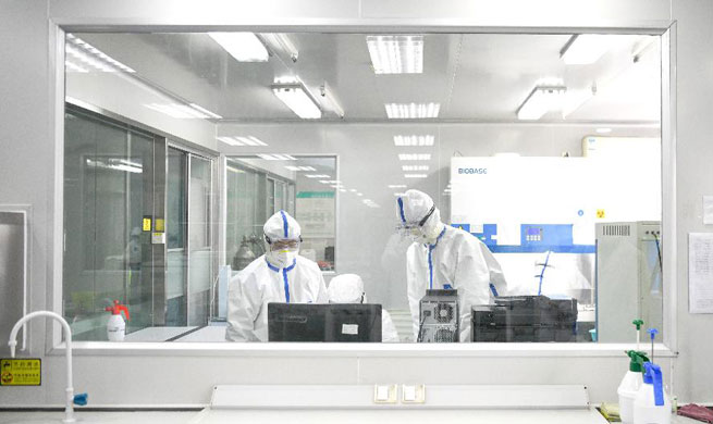 Laboratory in Wuhan conducts non-stop detection service