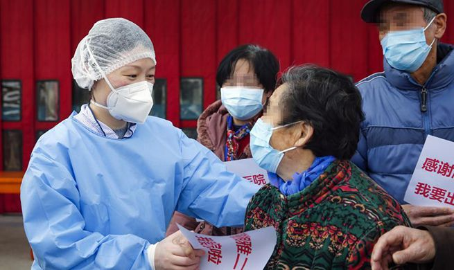Recovered COVID-19 patients discharged from hospital in Wuhan