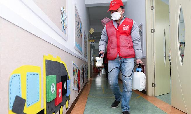 Volunteers conduct disinfection at kindergarten in Zhejiang