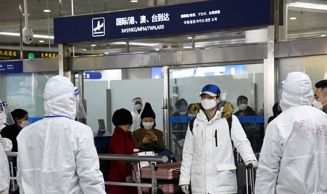 Xinhua Headlines: China fights novel coronavirus on two fronts