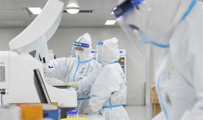 Pic story of medical staff conducting detections at Leishenshan Hospital