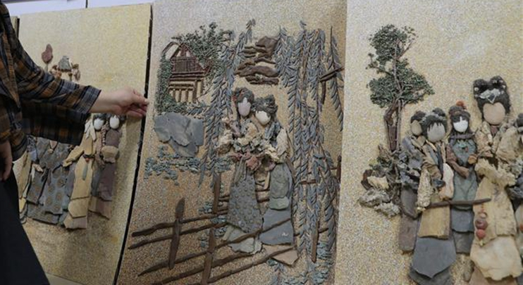 In pics: rock-picking painting artist Sheng Aiping