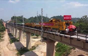 China-Laos railway's tracks go through 1st tunnel