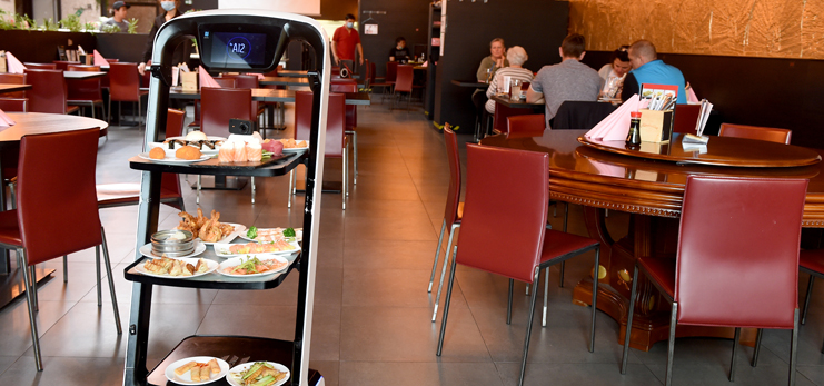 Robot delivers meals to customer at Asian restaurant in Vienna, Austria