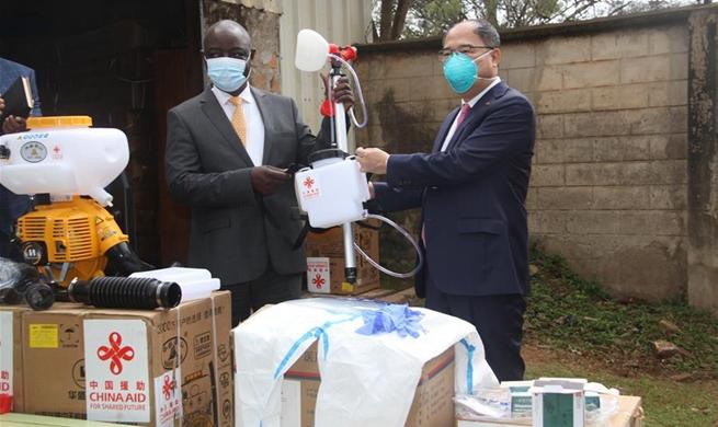 China donates chemicals, equipment in fight against locusts in Uganda