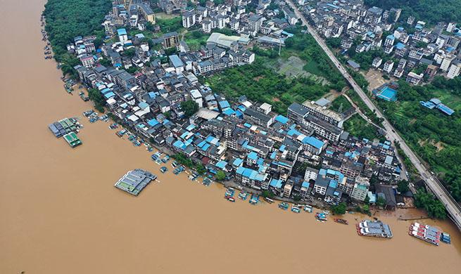Xinhua Headlines: China's flood-hit regions battle natural disasters