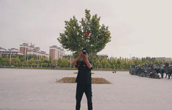 Young man in Xinjiang, China fulfills photography dreams