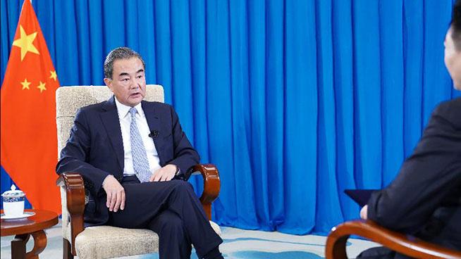 China, U.S. should advance relationship through cooperation: Wang Yi