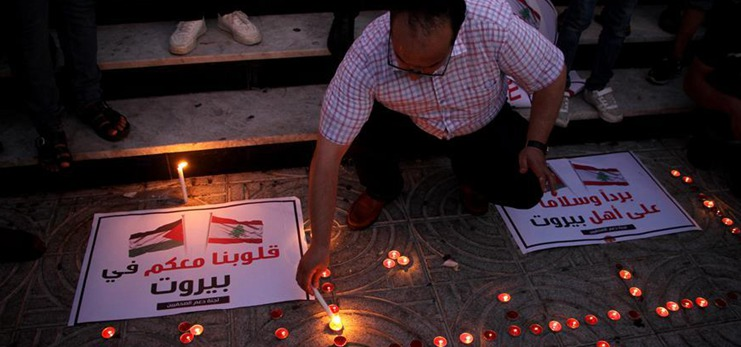 Palestinians express solidarity with Lebanon after massive explosions in Beirut