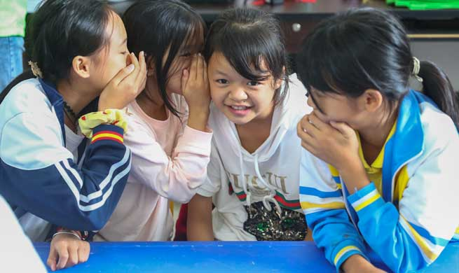 Children care pilot project contributes to children care work in Guangxi