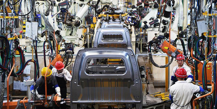 Workers assemble vehicles in smart factory in Chongqing