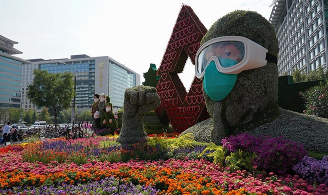 Flower decorations set up along Chang'an Avenue to celebrate Chinese National Day