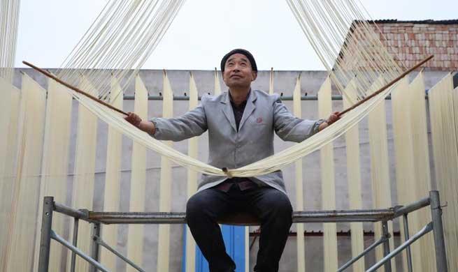 Villagers air noodles at Huangjiazhuang Village in Gansu, NW China