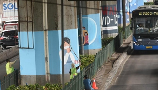 Indonesian artists paint mural in Jakarta, Indonesia