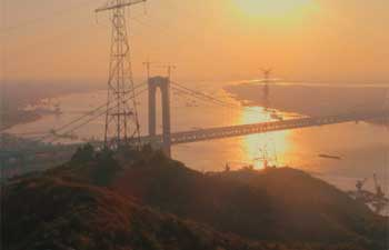 China's first road-rail suspension bridge open to traffic